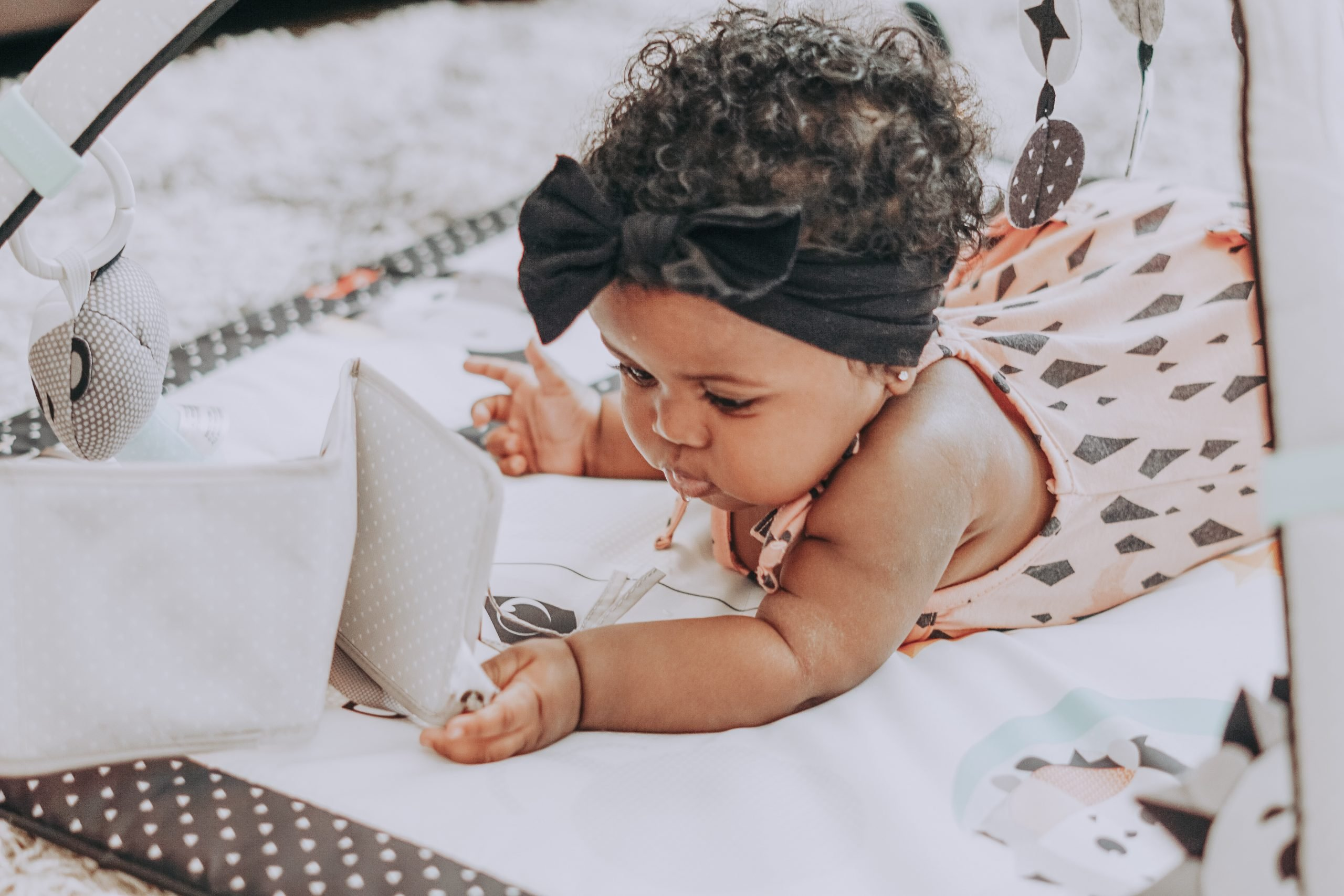 baby milestones to watch for and what to buy for them from Mommyhood Joy Blog is a Miami, FL Family, Travel, and Lifestyle Blog.